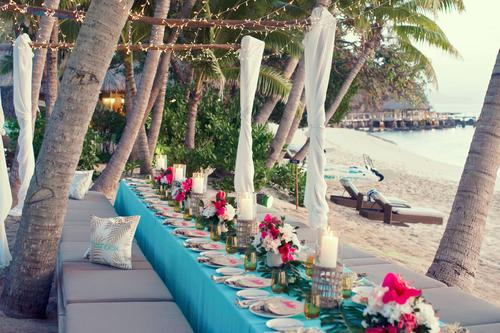A custom dining setup on the beach at Kokomo Private Island Fiji