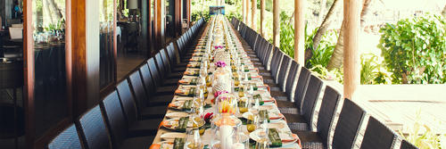 A large banquet dining table setup at Kokomo Private Island Fiji