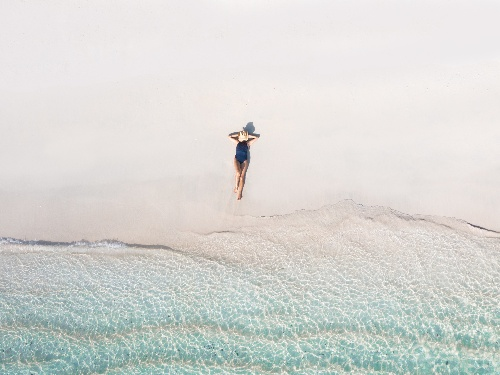 A guest snorkeling off the beach at Kokomo Private Island Fiji