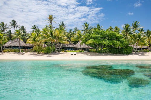 Beachfront villas at Kokomo Private Island Fiji viewed from the water