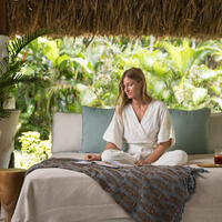 A guest relaxing on a lounge at the Yaukuve Spa Sanctuary at Kokomo Private Island Fiji